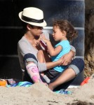 Injured actress Halle Berry and her daughter Nahla enjoying a day at the beach with her boyfriend Olivier Martinez in Malibu, CA on January 29, 2012. Halle and Nahla played in the sand. Afterwards Olivier and Nahla checked out a bird, swung on a swing and even shared a kiss.