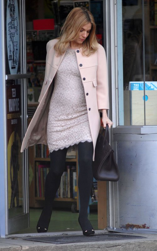 Sienna Miller Shows Off Her New Bump On Set