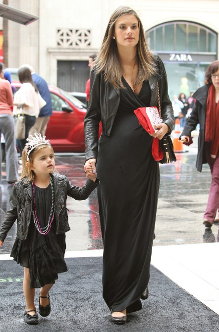 Model mom-to-be Alessandra Ambrosio attended the Mirror Mirror Premiere held at The Grauman's Chinese Theatre in Hollywood, California on March 17th, 2012 with her daughter Anja Ambrosio Mazur and a friend.