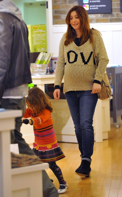 Expecting actress Alyson Hannigan and her daughter Satyana Denisof out shopping for baby stuff in Santa Monica, CA on February 28, 2012