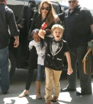 Angelina Jolie arrives at LAX Airport with her daughters Shiloh and Zahara to catch a flight out out town on March 12, 2012 in Los Angeles, CA.
