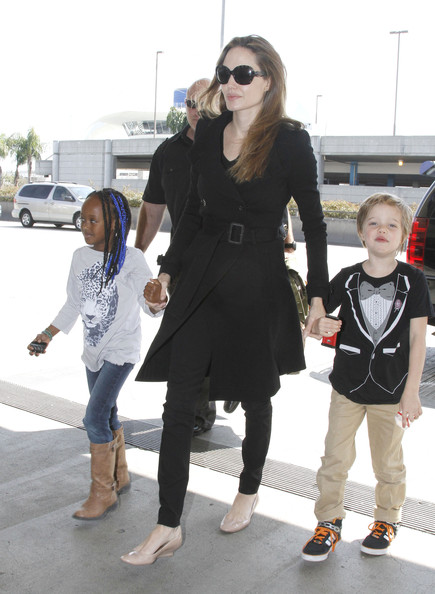 Angelina Jolie Jets Off With Her Girls