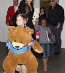 Angelina Jolie arriving on a flight from Amsterdam at LAX Airport with her daughters Shiloh and Zahara (March 15)