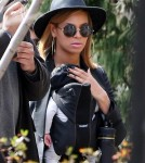 Beyonce Knowles took a stroll with her baby daughter Blue Ivy Carter strapped to her chest on March 12, 2012 through New York City, New York with her mother Tina Knowles.