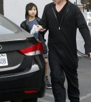Actor Brad Pitt and son Maddox Jolie-Pitt buying a guitar and an amplifier at Guitar Center in Hollywood, CA on March 1, 2012