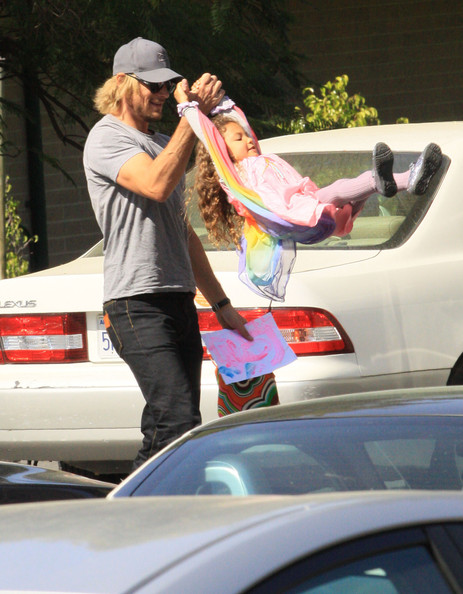 Gabriel Aubry picking up daughter Nahla from school and having some on the way to the car in Los Angeles, CA on March 2, 2012.