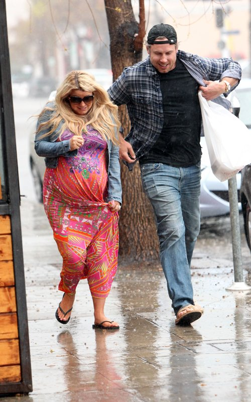 Jessica Simpson and Eric Johnson brave the rain in Palm Springs March 25