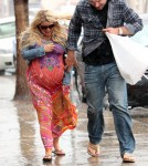 Jessica Simpson and Eric Johnson braving the rain in Palm Springs March 25