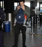 Orlando Bloom arrives at LAX Airport with his son Flynn to catch a flight out of town on March 4, 2012 in Los Angeles, CA.