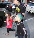 Blink 182 drummer Travis Barker takes his children Landon and Alabama to the doctor's office on March 12, 2012 in Beverly Hills, CA. The family all walked out with lollipops after the visit. Landon looks to be a chip off the old block, with his hair dyed bright blue and purple!