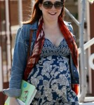 "Alyson Hannigan shows off her baby bump in a dress while doing some shopping in Los Angeles. The ""How I Met Your Mother Star"", who is currently expecting her second child with husband Alexis Denisof, was all smiles as she walked to her car."