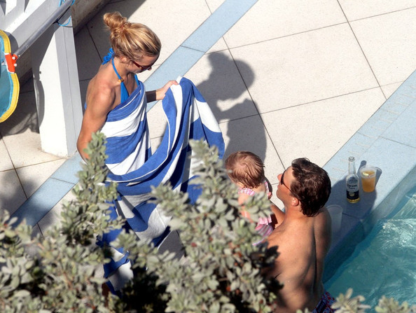 Supebowl champ, Eli Manning, relaxes with some beers in the pool of his Miami Beach hotel. Manning is joined by his wife, Abby McGrew, and baby daughter Ava Frances