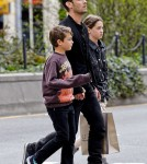 Jude Law has a busy afternoon as he takes his children Rudy and Iris street art shopping in Soho, New York City