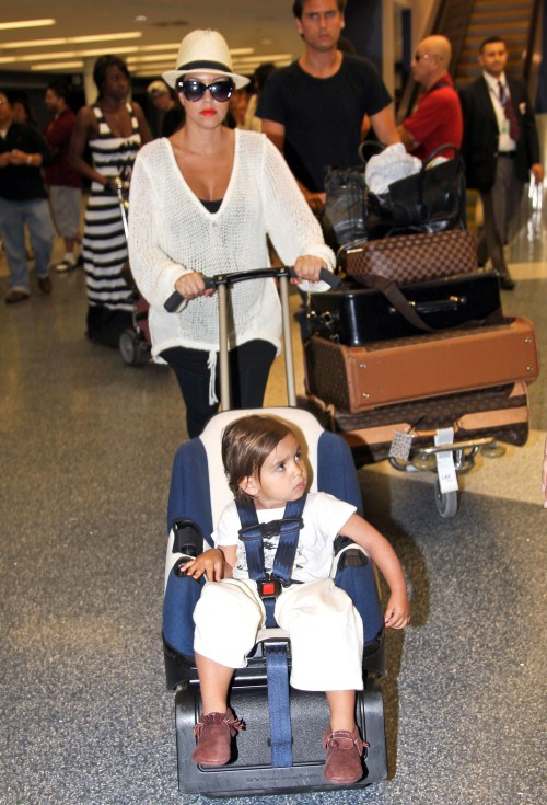 Pregnant birthday girl Kourtney Kardashian, fiance Scott Disick and son Mason arriving on a flight at Los Angeles International Airport in Los Angeles, California on April 18, 2012. Kourtney was celebrating her 32nd birthday today