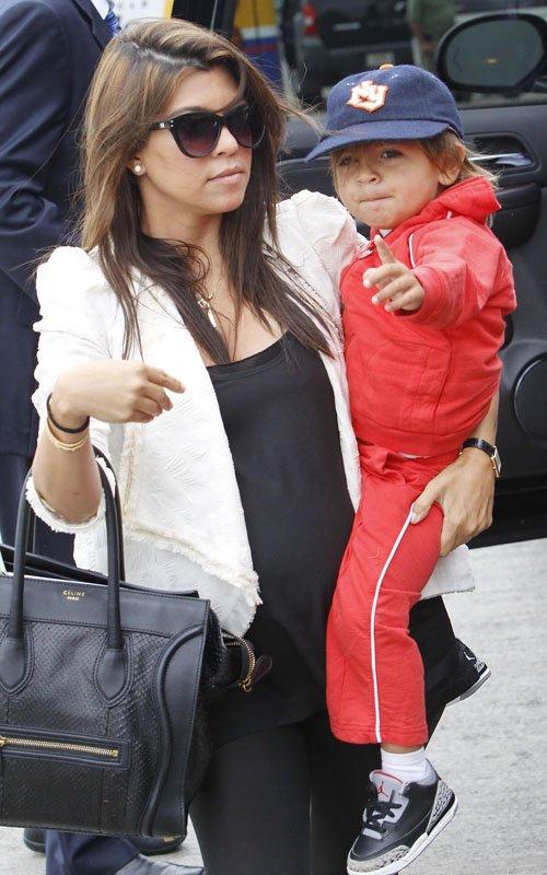 Kourtney Kardashian with son Mason Disick at LAX - April 21