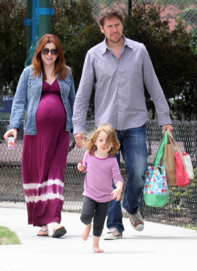 Pregnant Alyson Hannigan spends family time at the park (Photos)