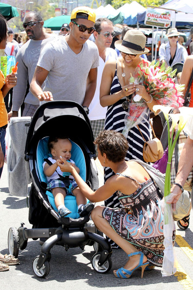 Tia Mowry and husband Cory Hardrict enjoy a day with their baby son Cree at the Farmer's Market in LA