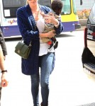 Charlize Theron with her son Jackson at LAX airport in Los Angeles, CA May 7