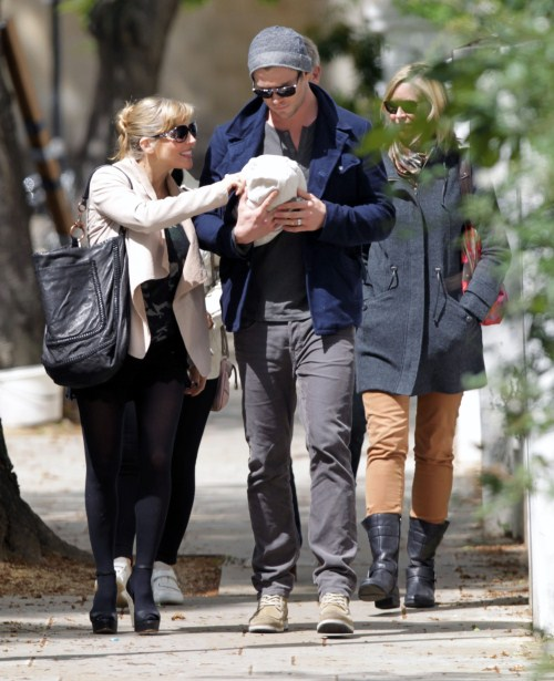 """""""Thor"""" star Chris Hemsworth and his wife Elsa Pataky take a walk through London, England on May 16, 2012 with their newborn daughter India Rose (born on May 11, 2012). They were joined by Chris and Elsa's family."""