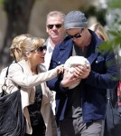 """Thor"" star Chris Hemsworth and his wife Elsa Pataky take a walk through London, England on May 16, 2012 with their newborn daughter India Rose (born on May 11, 2012). They were joined by Chris and Elsa's family."
