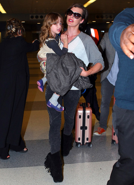 """""""Resident Evil"""" actress Milla Jovovich arrived at JFK Airport in New York on May 6, 2012. The actress had her daughter Ever Anderson riding along on her luggage."""