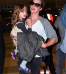 """Resident Evil"" actress Milla Jovovich arrived at JFK Airport in New York on May 6, 2012. The actress had her daughter Ever Anderson riding along on her luggage."