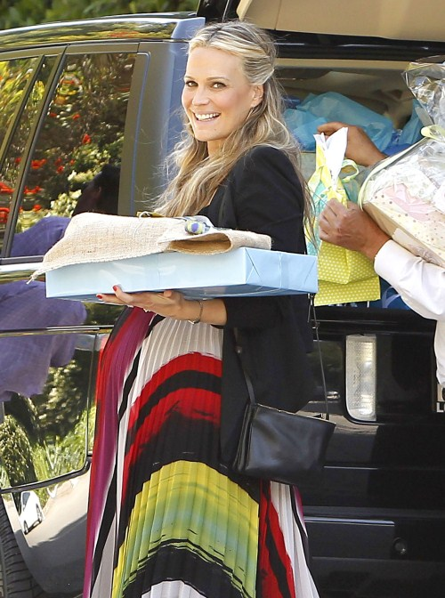 Molly Sims receiving lots of gifts at her baby shower at a Hollywood Hills private residence in Hollywood, California on May 5, 2012. Molly's husband Scott Stuber came to pick her up after the party