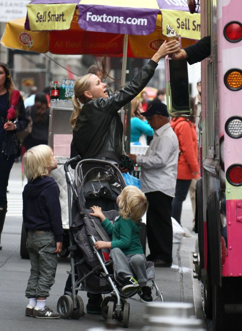 Actress Naomi Watts and her sons Alexander and Samuel stopping to get ice cream while on a walk in New York City, New York on May 9, 2012.