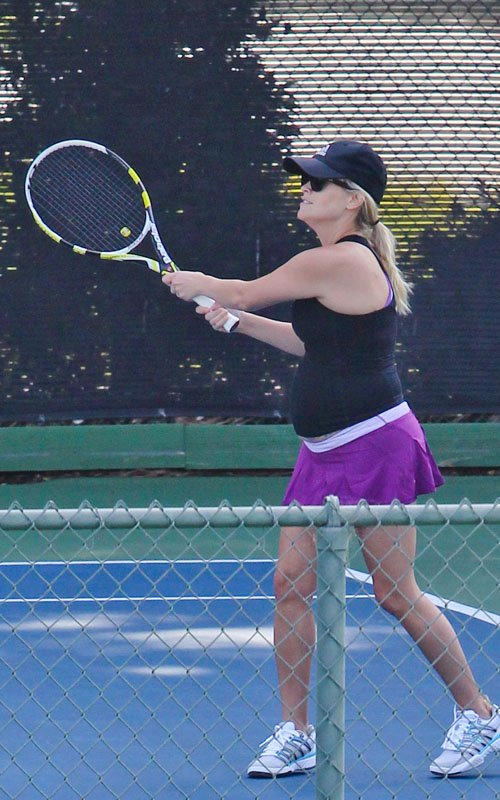 Reese Witherspoon playing tennis at Brentwood Country Club in Los Angeles, California May 16