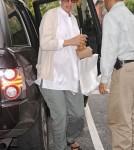 Pregnant actress Uma Thurman arrives at her apartment carrying fresh orange juice