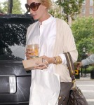 Pregnant actress Uma Thurman arrives at her apartment carrying fresh orange juice