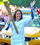 "ormer ""Spice Girl"" Melanie Chisholm, Mel C, starts her run with the Olympic Torch in Liverpool, England on June 1, 2012.."