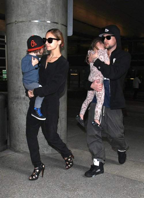 Nicole Richie and her husband Joel Madden arriving with their kids at LAX - June 19
