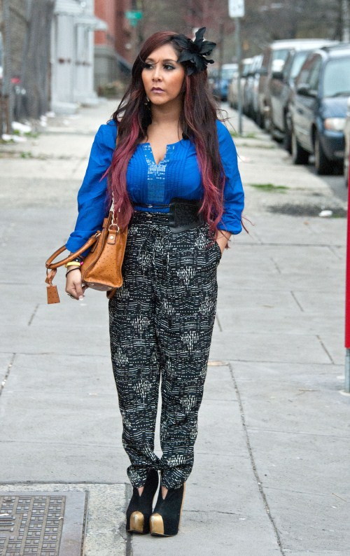 """Pregnant """"Jersey Shore"""" star Nicole """"Snooki"""" Polizzi and Jenni """"JWoww"""" Farley film their new reality show, """"Snooki and JWoww Vs. The World"""" around town on March 21, 2012 in Jersey City, NJ. The girls stopped by a psychic and picked up their colorfully dyed dogs from day care."""