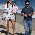 Model Alessandra Ambrosio enjoyed a stroll down the beach in Malibu, California on July 14, 2012 with her newborn son Noah and her long-term fiance Jamie Mazur.