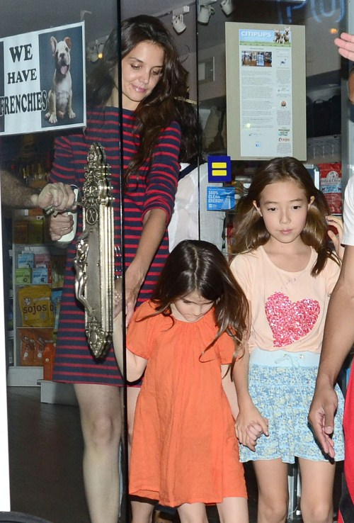 Katie Holmes takes her daughter Suri and a friend to a pet store to look at some puppies in New York City, New York on July 14, 2012.