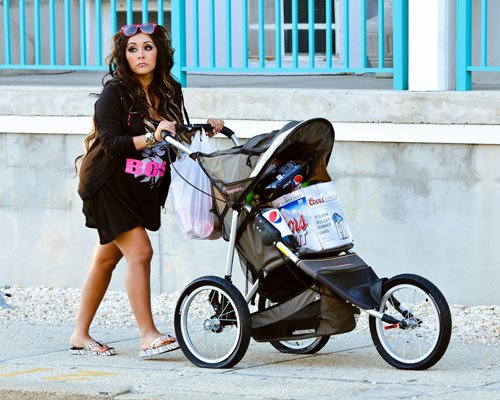 Snooki pushing a stroller full of beer and soda in Seaside Heights (July 2).