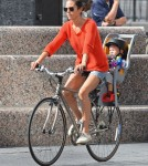 Jennifer Connelly and husband Paul Bettany out for a bike ride with their children Stellan and Agnes in New York City, New York on August 29, 2012.