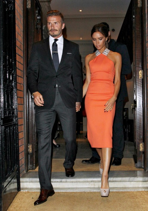 Soccer star David Beckham and his wife Victoria make their exit after attending Simon Fuller's birthday party in London, England on July 9, 2012.