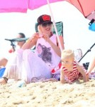 Singer Gwen Stefani and her sons Kingston and Zuma enjoying a day on the beach with friends and family members in Newport Beach, California on August 19, 2012.