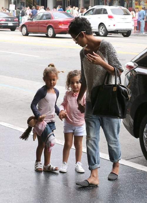 Halle Berry takes her daughter Nahla and a friend to the movies in Hollywood, California on August 25th, 2012.