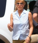 "Wanderlust"" star Jennifer Aniston was spotted being escorted to an awaiting SUV in to head to the theatre after an early day on the set of ""We're the Millers"" in Wilmington, North Carolina on August 17, 2012."