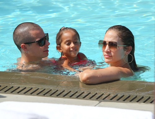 Jennifer Lopez and her boyfriend Casper Smart take her kids Emme and Max to the pool at their hotel in Miami, Florida on August 30, 2012.