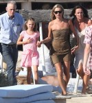 Model Kate Moss and her daughter Lila take a walk on the beach while vacationing in Saint-Tropez, France on August 16, 2012.