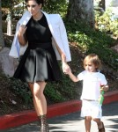 Kim and Kourtney Kardashian arrived at a church in Thousand Oaks, California on August 26, 2012. Kourtney had her children daughter Penelope and son Mason Disick with them for the service. Kim made sure Mason was taken care of while mom Kourtney kept his new baby sister covered on the way into the church.