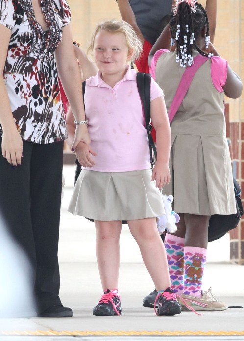 'Here Comes Honey Boo Boo' star Alana Thompson waiting with her teacher for her ride home from school in McIntyre, Georgia on September 12, 2012.