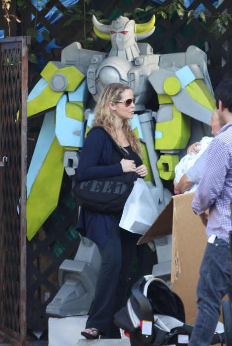 Elizabeth Berkley, her husband Greg Lauren and their new born son Sky Lauren out shopping at Bel Bambini in Beverly Hills, California on September 17, 2012.