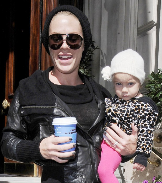 Pink is all smiles as she leaves her hotel carrying daughter Willow and a cup of coffee on September 13, 2012 in London, England.