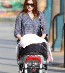 Alyson Hannigan was spotted taking her baby girl, Keeva Denisof, for a walk in Santa Monica, California on September 28, 2012.