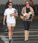 Katherine Heigl, her mom Nancy, husband Josh and new baby Adalaide arriving on a flight at LAX airport in Los Angeles, California on September 6, 2012. The family was met at the airport by her adopted sister Meg Heigl